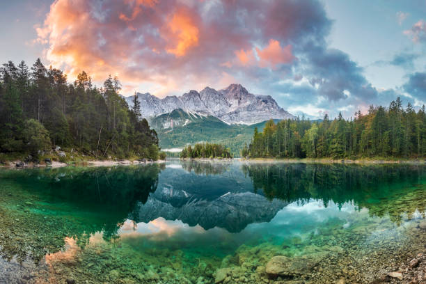 mountain peak zugspitze summer day at lake eibsee near garmisch partenkirchen. bavaria, germany - germany stock pictures, royalty-free photos & images