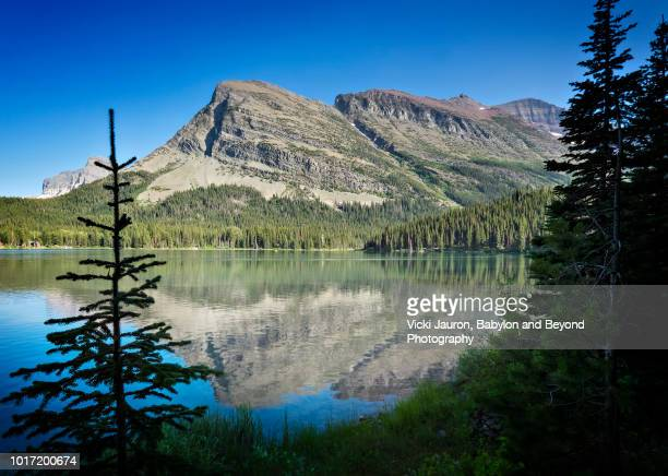 Mountain Peaks and Reflection at Swiftcurrent Lake at Many Glacier, Montana