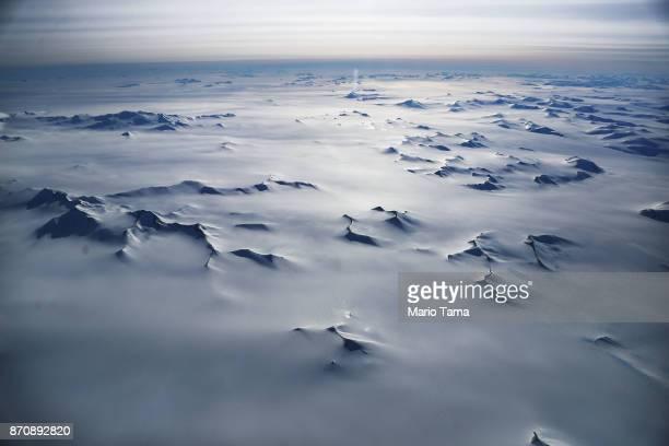 Mountain peaks are seen from NASA's Operation IceBridge research aircraft in the Antarctic Peninsula region on November 4 above Antarctica NASA's...
