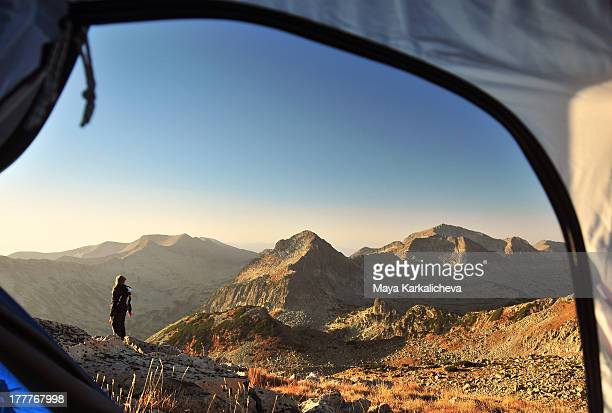 mountain peaks, view from tent at sunrise - pirin national park stock pictures, royalty-free photos & images