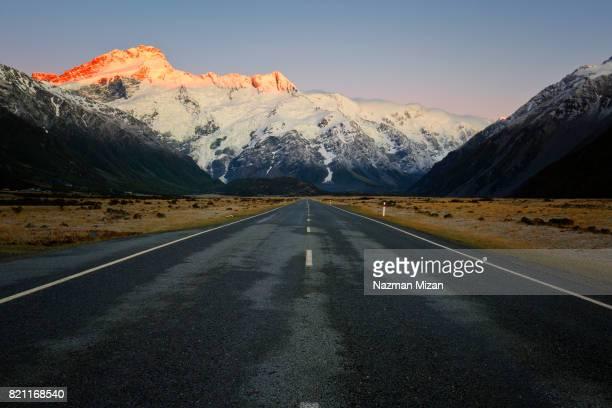 mountain peaks was illuminated by the rising sun. - porträt bildbanksfoton och bilder