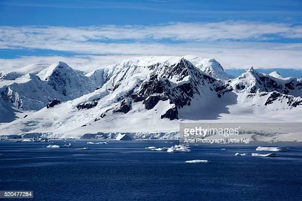 mountain range along danco coast, west coast of the antarctic peninsula - antarctic peninsula stock pictures, royalty-free photos & images