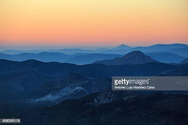 mountain range at sunset - 尾根 ストックフォトと画像