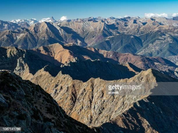 mountain range in the alps. - alpi foto e immagini stock