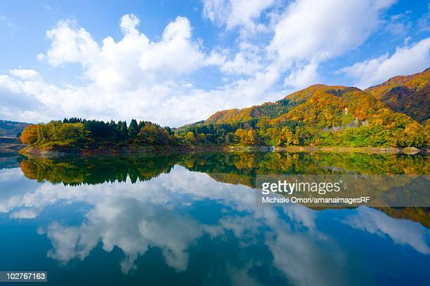 mountain range reflected in a lake in autumn. aomori prefecture, japan - mirror lake stock pictures, royalty-free photos & images