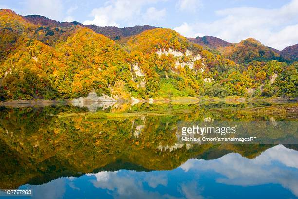 Mountain range reflected in a lake in autumn. Aomori Prefecture, Japan
