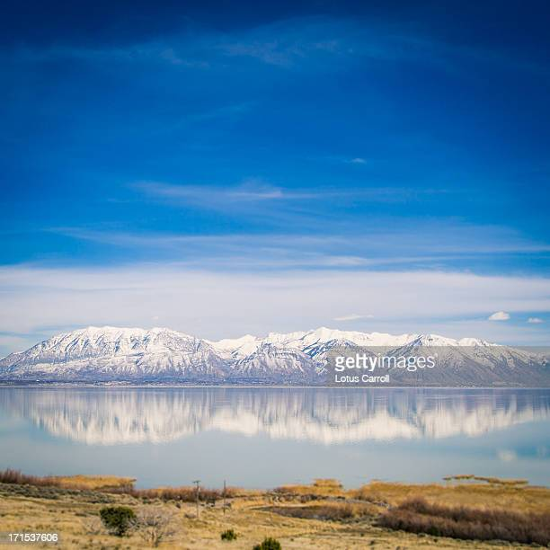 Mountain Range reflected in blue water