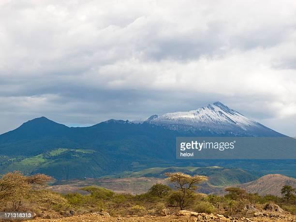 mountain range under cloudy sky at mt. menu. - mount meru stock photos and pictures