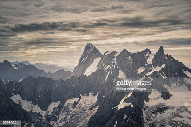 Mountain range under cloudy sky