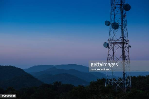 mountain range with commuication in twilight time after sun set - tower stock pictures, royalty-free photos & images