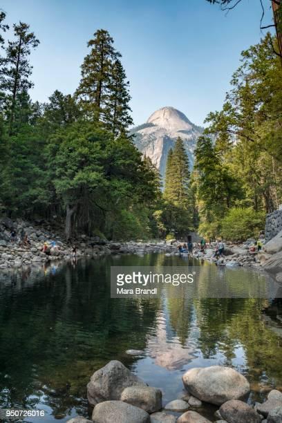 Mountain reflected in Merced River, North Dome, John Muir Trail, Yosemite Valley, Yosemite National Park, UNESCO World Heritage Site, California, USA