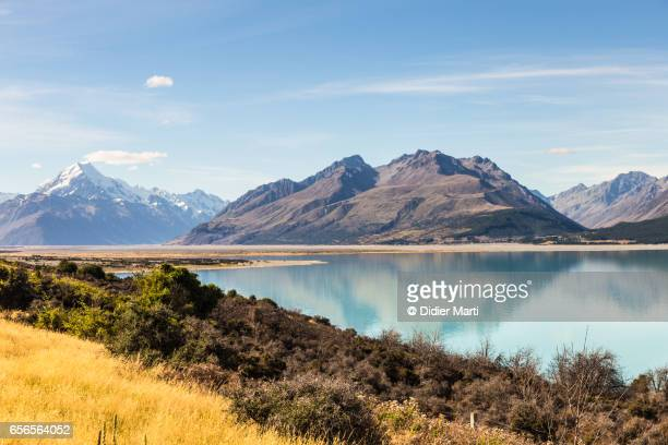 Mountain reflecting in the turquoise water of lake Pukaki in New Zealand