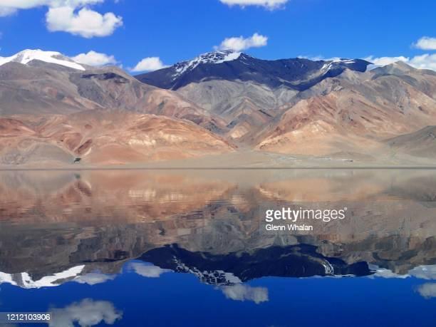 mountain reflection - pareidolia stock pictures, royalty-free photos & images