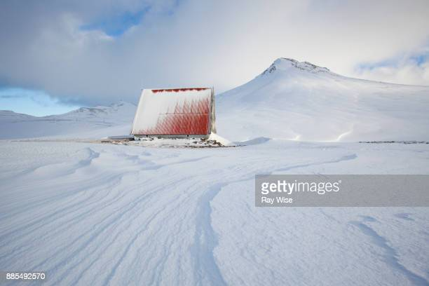Mountain refuge hut in the deep snow