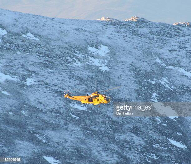 CONTENT] Mountain rescue helicopter over Cairngorm Scotland