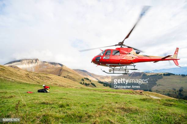 Mountain Rescue Helicopter Takes Off From Mountain Side