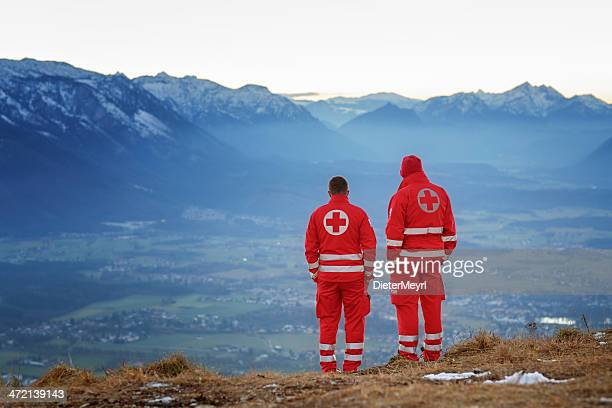 mountain rescue - red cross helper in mountain - rescue worker stock pictures, royalty-free photos & images