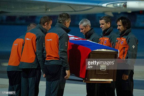 Mountain rescuers carry the coffins with the remains of Peter Sperka and Anton Dobes, two Slovakian climbers killed in Pakistan, in Bratislava...