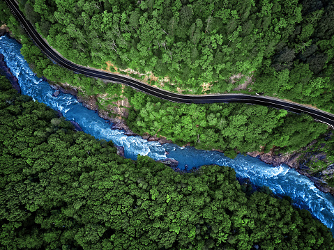 Mountain river and road aerial view 942147458
