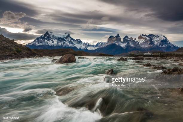 Mountain river at sunset with a view of the mountains. Torres del Paine, Chile
