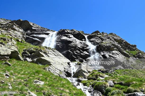 mountain river falls in several cascade - puletto diego stock pictures, royalty-free photos & images