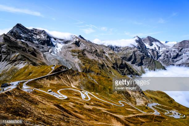 Mountain road and sea of clouds mountains against sky in Austrian Alps