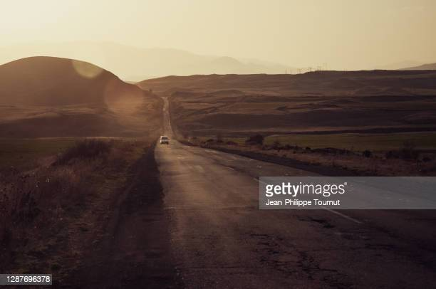 mountain road at golden hour in the zangezur mountains, south caucasus, near the town of goris, syunik province, armenia - eurasia stock pictures, royalty-free photos & images