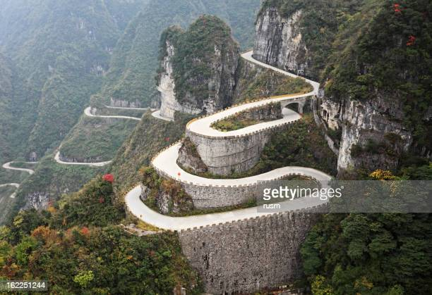 mountain road, china - tianmen stock pictures, royalty-free photos & images