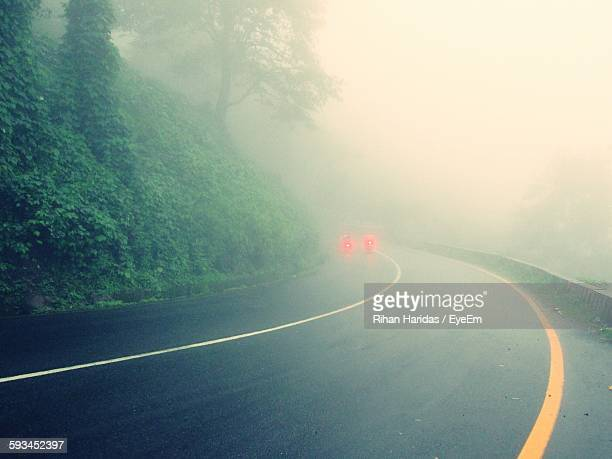 Mountain Road In Foggy Weather