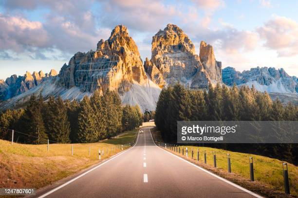 mountain road in the dolomites, italy - travel destinations stock-fotos und bilder
