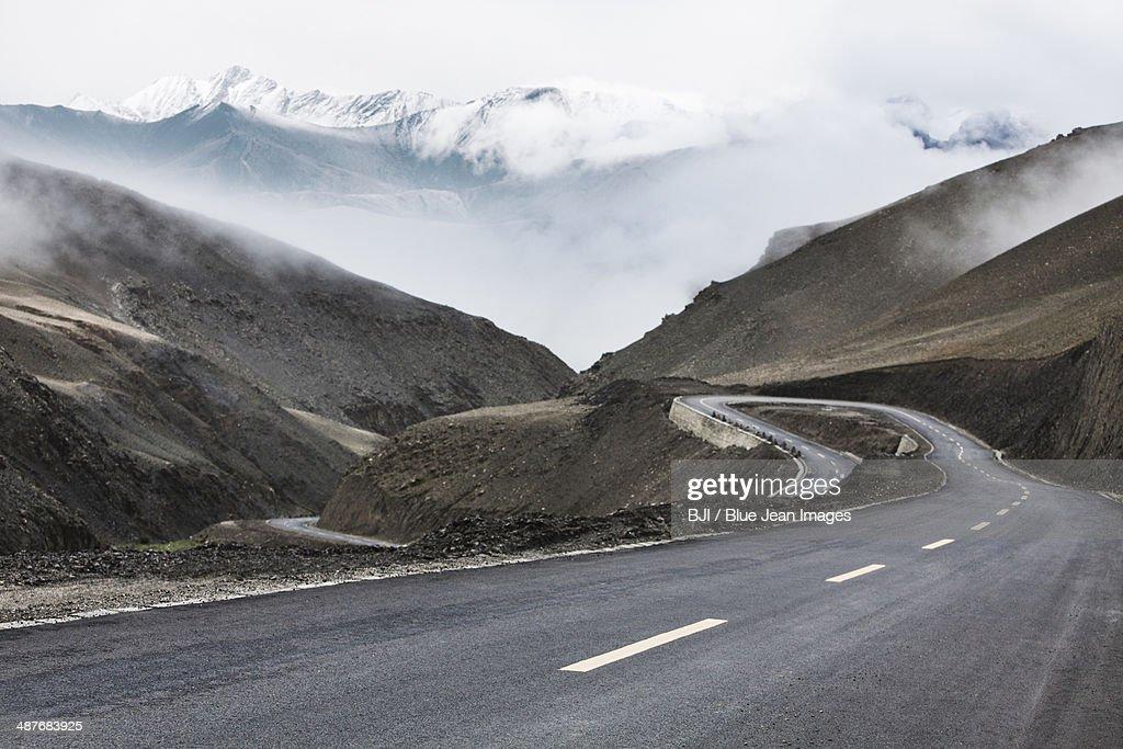 Mountain road in Tibet, China : Stock Photo