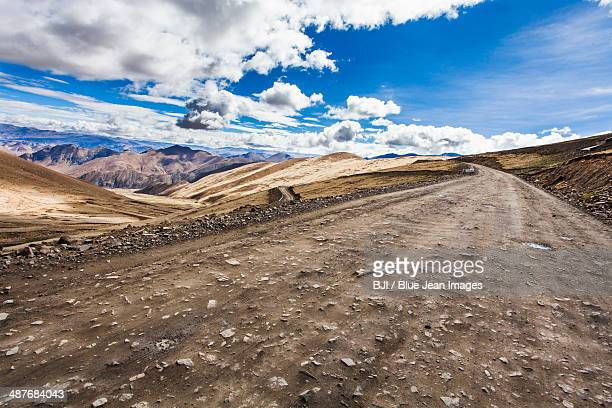 mountain road in tibet, china - bumpy stock photos and pictures