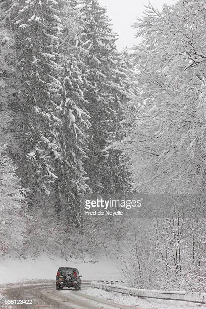 mountain road in winter - sallanches stock pictures, royalty-free photos & images