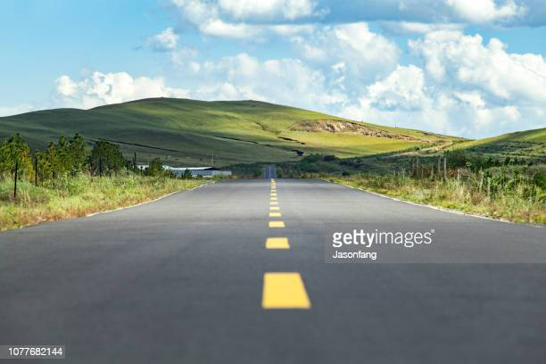 mountain road - mountain road stock pictures, royalty-free photos & images