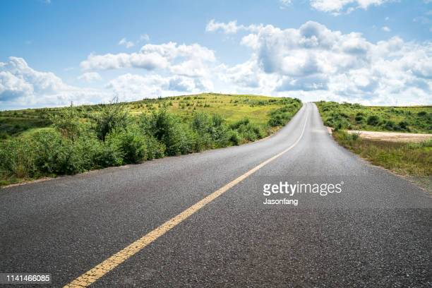mountain road - country road stock pictures, royalty-free photos & images