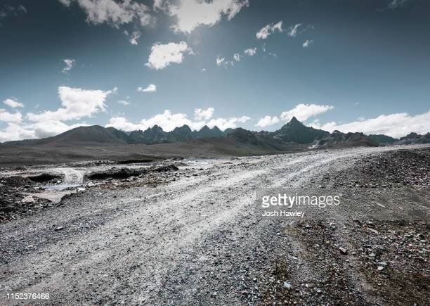 mountain  road - dirt road stock pictures, royalty-free photos & images