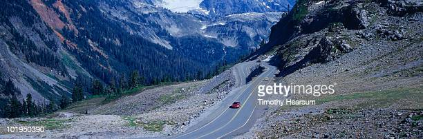 mountain road with switchback - timothy hearsum stockfoto's en -beelden
