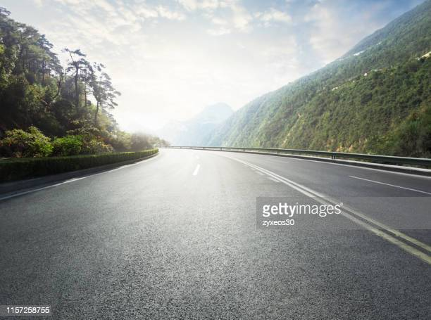 mountain road,natural tourist area. - autostrada foto e immagini stock