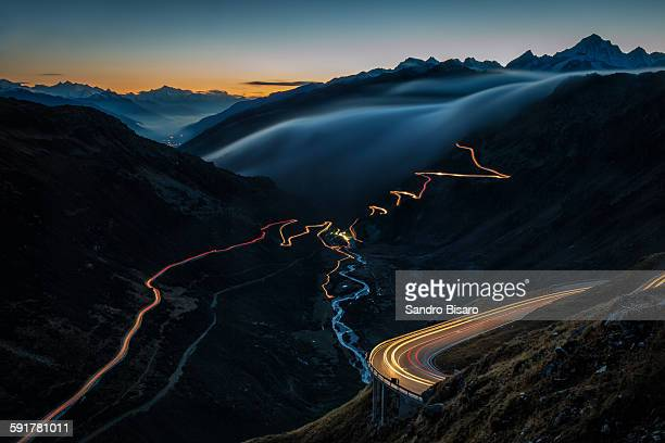Mountain roads at sunset with traffic lights