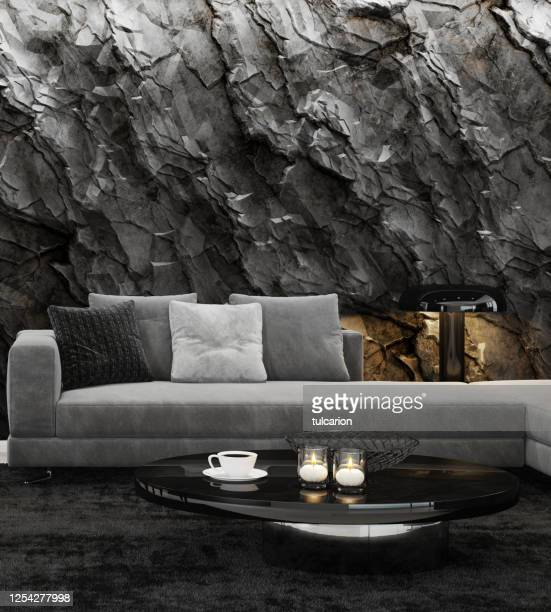 mountain rock stone wall in luxurious apartment living room interior - modern rock stock pictures, royalty-free photos & images