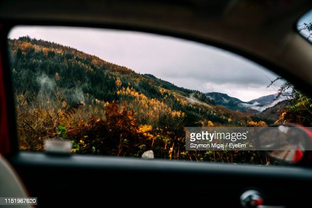 mountain seen through car window during autumn - snowdonia stock photos and pictures