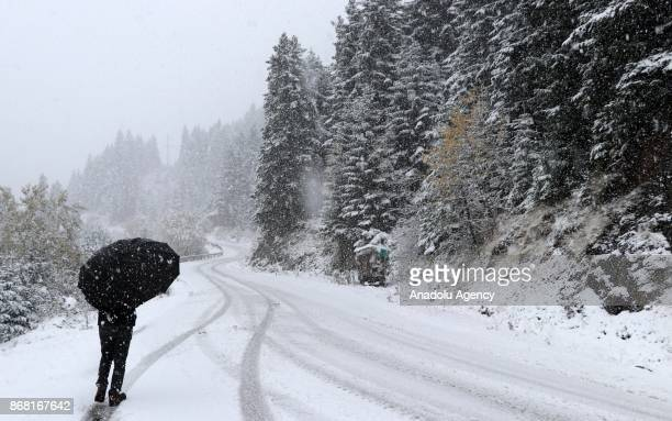 A mountain sees first snowfall of season at Lake Abant Nature Park in Bolu Turkey on October 30 2017 Precipitation left 10 centimeters of snow depth...