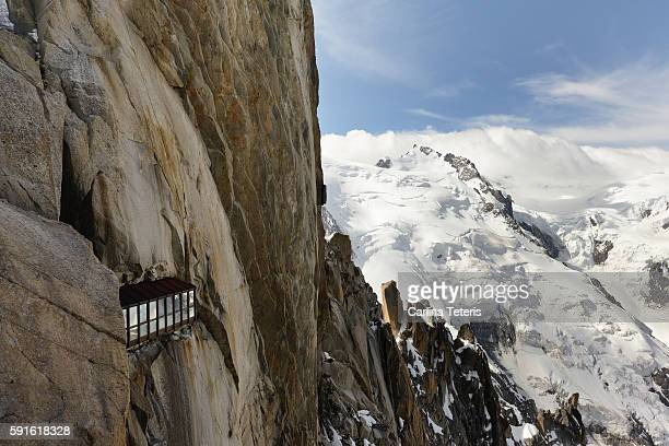 mountain side view point built into a stone cliff - aiguille de midi stock photos and pictures