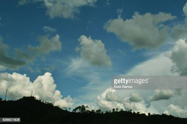 Mountain silhouette and clear sky with clouds at dusk
