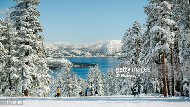 mountain skiing with lake view - lake tahoe stock pictures, royalty-free photos & images