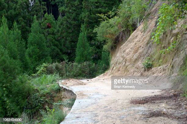 mountain sliding onto road - landslide stock pictures, royalty-free photos & images