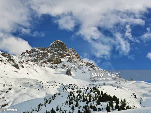 mountain snow and sky - courchevel stock pictures, royalty-free photos & images