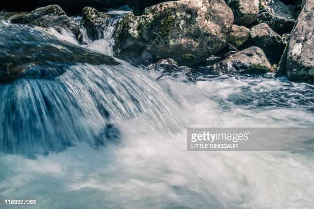 mountain stream. at akame 48 waterfalls. long exposure. close-up - ruscello foto e immagini stock