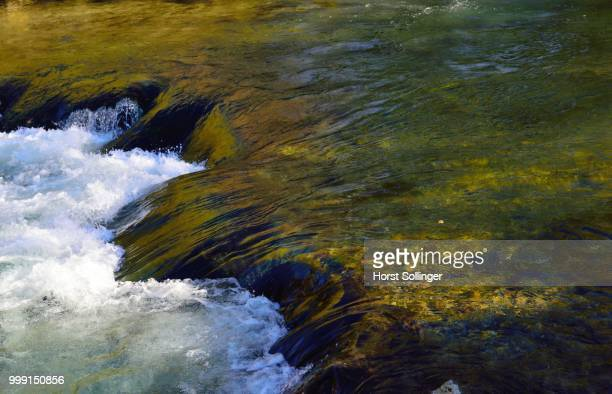 Mountain stream cascading over moss-covered rocks near Fischbachau, alpine upland, Upper Bavaria, Bavaria, Germany