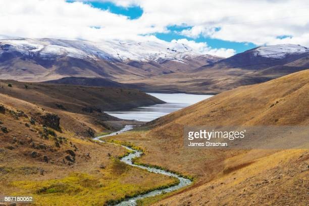 mountain stream feeding spandaryan reservoir with zanzegur mountains in the background, vorotan pass, armenia - armenia stock pictures, royalty-free photos & images